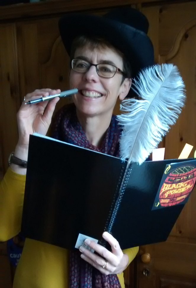 Ally Sherrick with stationery and quill pen