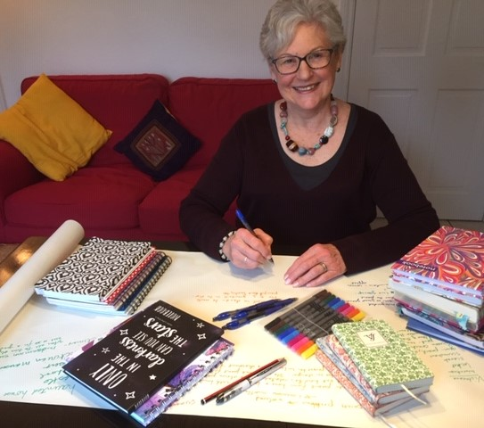 Donna with writing tools