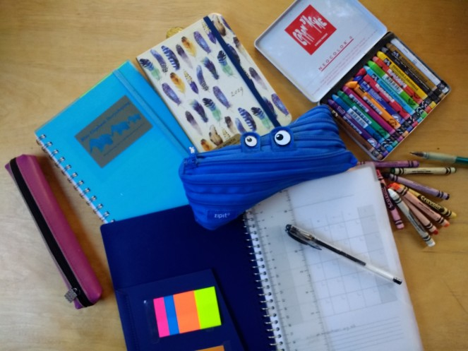 notebooks, pencil cases and crayons